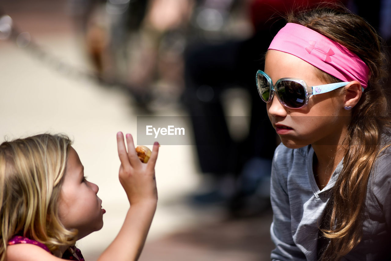 child, sunglasses, childhood, glasses, women, females, headshot, focus on foreground, real people, girls, portrait, fashion, leisure activity, lifestyles, two people, casual clothing, people, family, hair, hairstyle, innocence