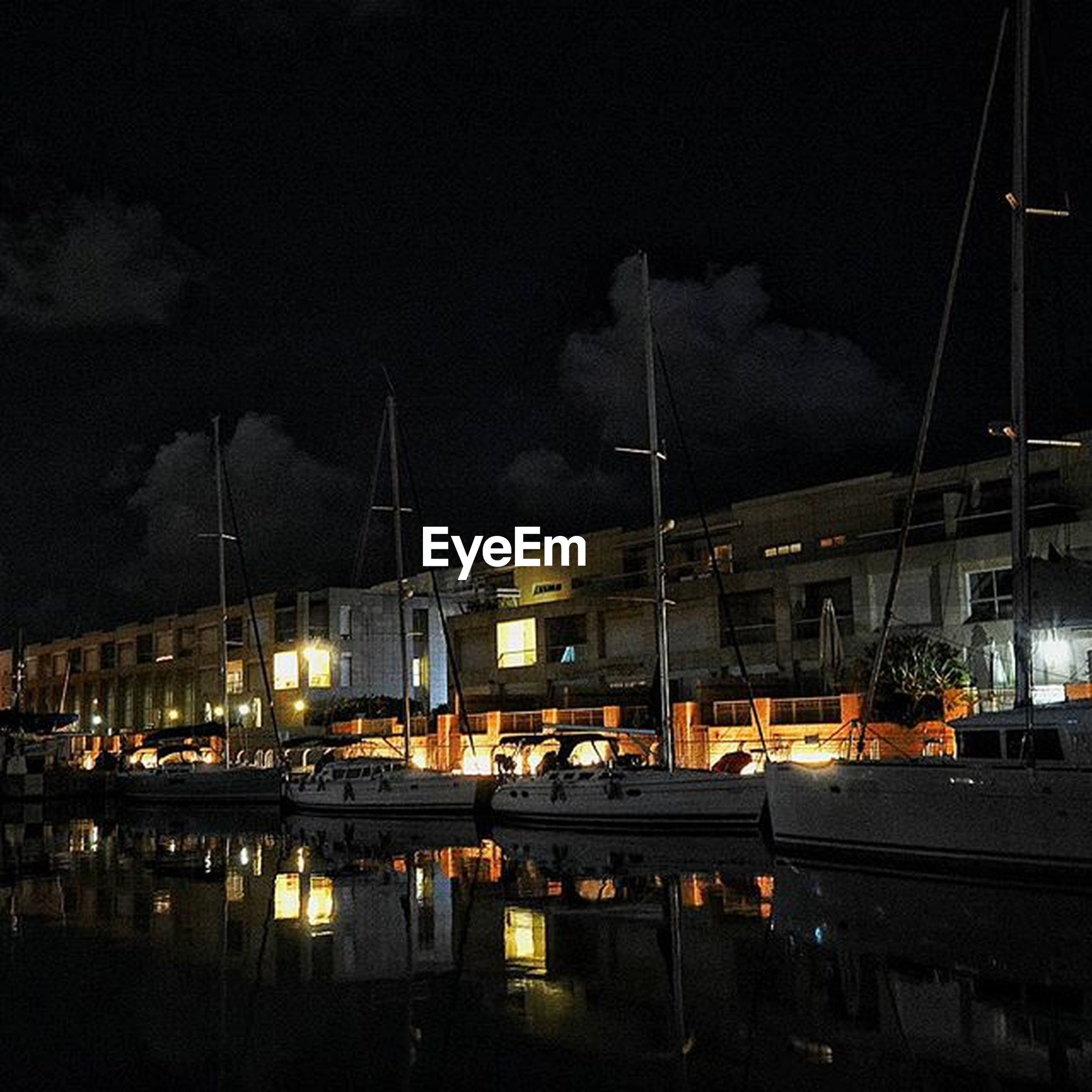 architecture, water, illuminated, night, built structure, building exterior, reflection, sky, river, transportation, waterfront, nautical vessel, mode of transport, harbor, city, moored, outdoors, lake, boat, dusk