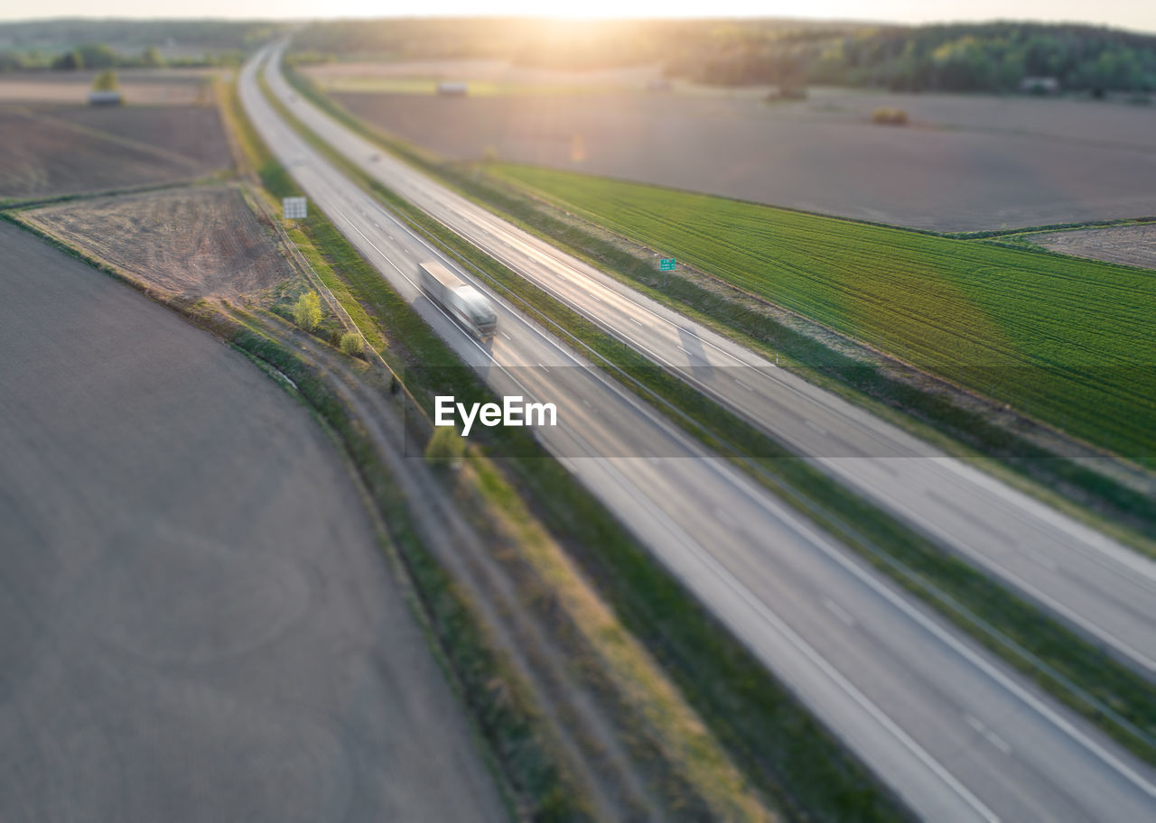 Blurred motion of vehicle on road during sunset