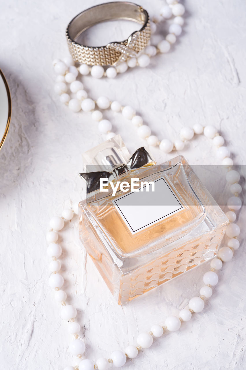 jewelry, pearl jewelry, necklace, white color, still life, high angle view, no people, close-up, wealth, jewelry box, luxury, indoors, gold colored, box, container, personal accessory, ring, bracelet, fashion, womenswear