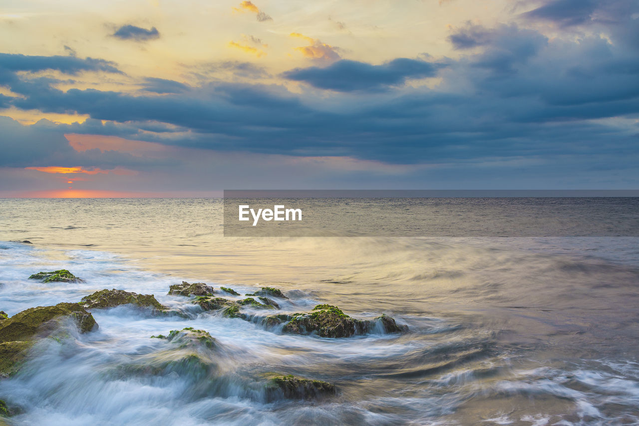 sky, sea, cloud - sky, beauty in nature, water, horizon over water, scenics - nature, horizon, sunset, motion, beach, land, no people, wave, nature, idyllic, tranquil scene, sport, aquatic sport, outdoors, power in nature