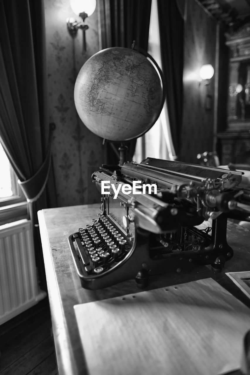 indoors, no people, music, table, musical instrument, technology, arts culture and entertainment, retro styled, metal, still life, close-up, lighting equipment, antique, musical equipment, high angle view, day, typewriter, illuminated, wood - material, electric lamp