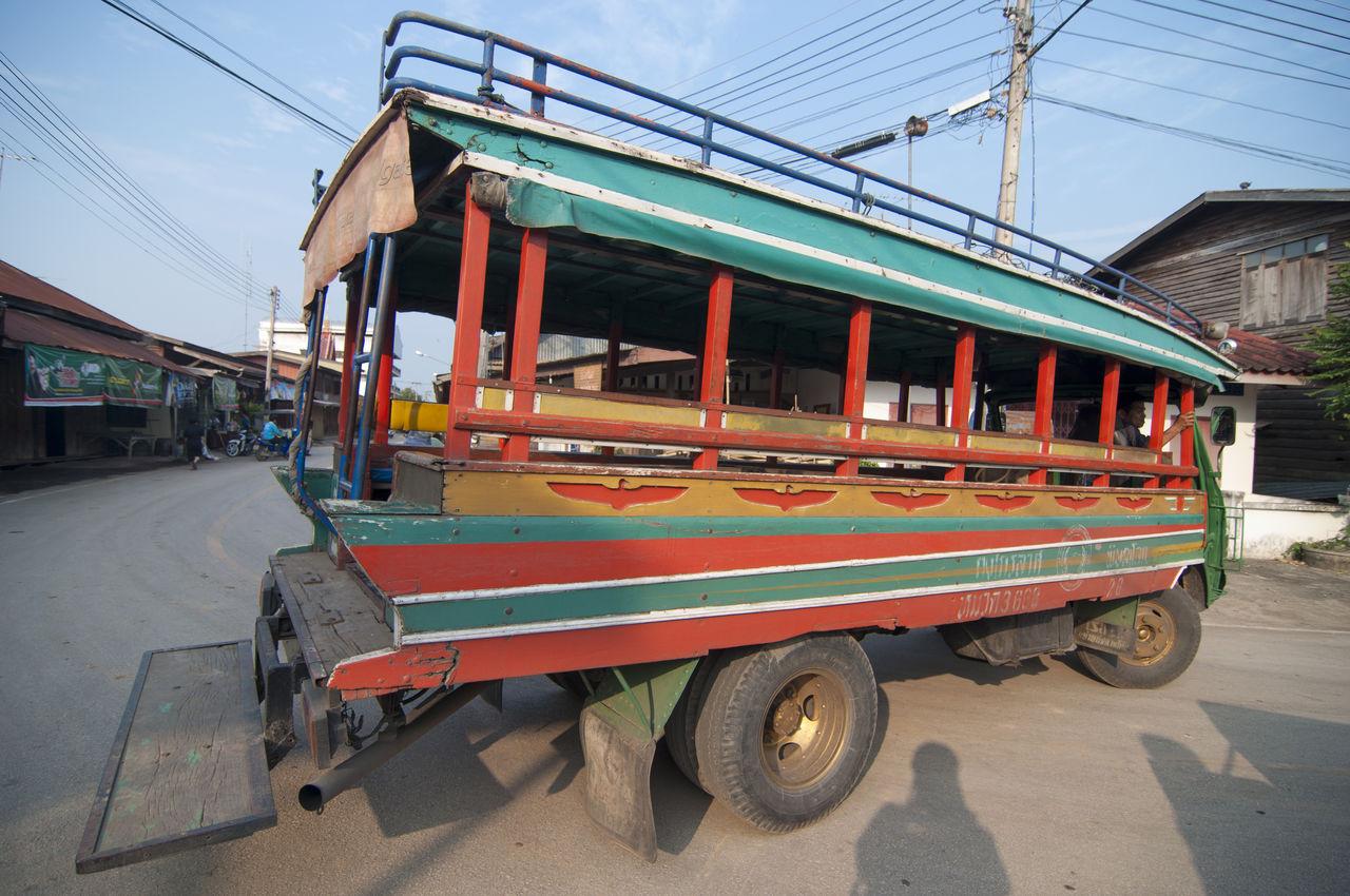Wooden public car on street
