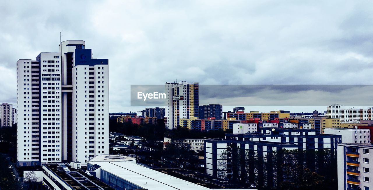 architecture, building exterior, built structure, skyscraper, city, sky, modern, cloud - sky, cityscape, development, no people, day, city life, outdoors, building story, growth, tall, travel destinations, urban skyline