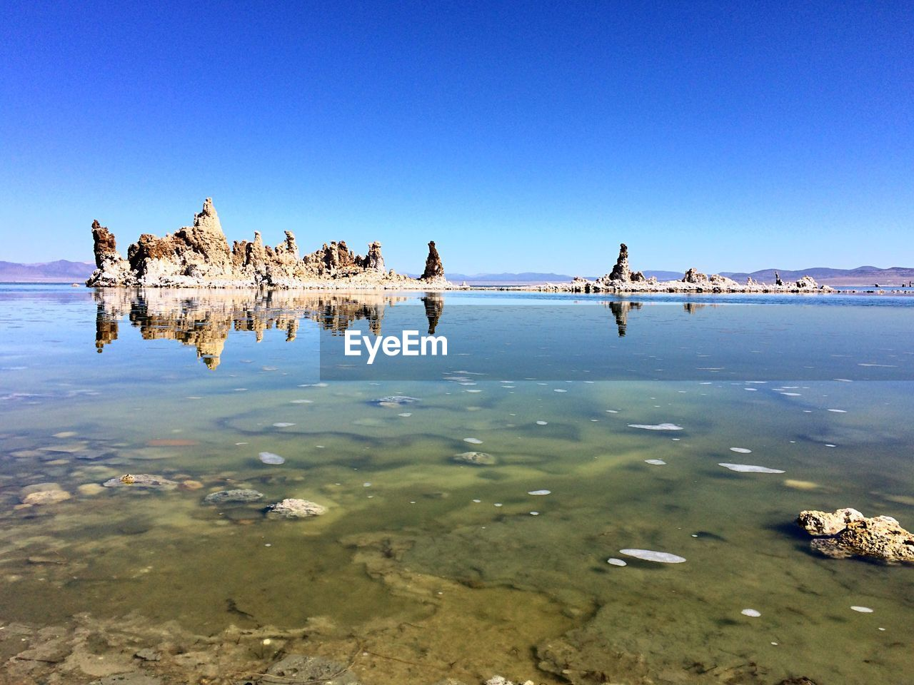Scenic shot of calm lake with rock formations