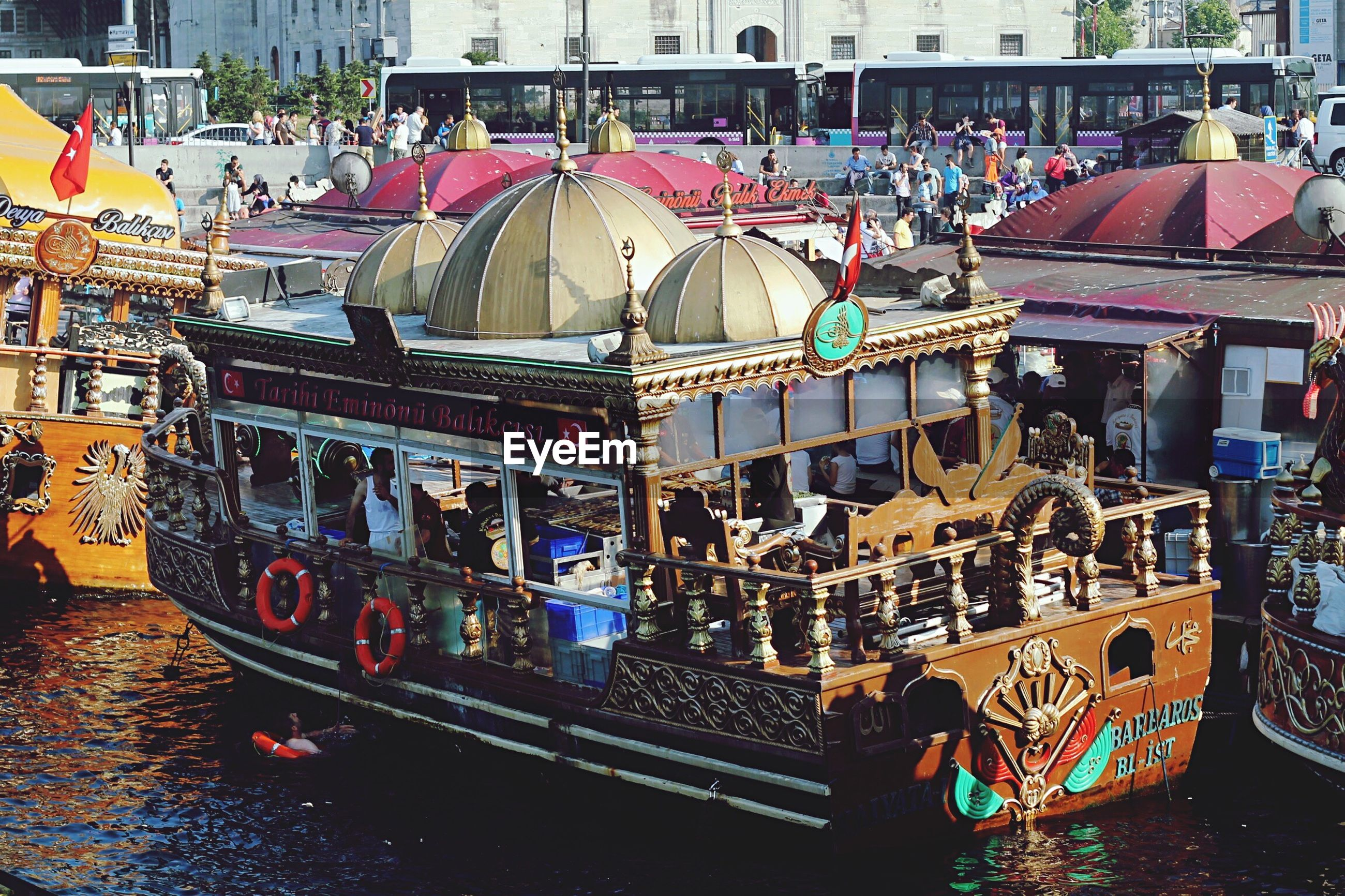 building exterior, built structure, architecture, transportation, mode of transport, market, city, large group of objects, abundance, retail, multi colored, market stall, day, outdoors, moored, variation, nautical vessel, incidental people, in a row, hanging