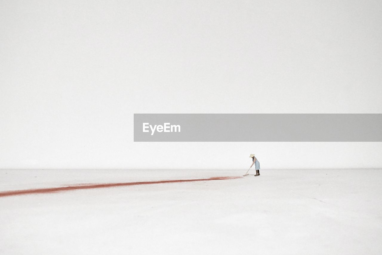 copy space, full length, winter, one person, ice-skating, winter sport, ice rink, snow, sport, cold temperature, men, real people, ice skate, white background, nature, day, outdoors, people