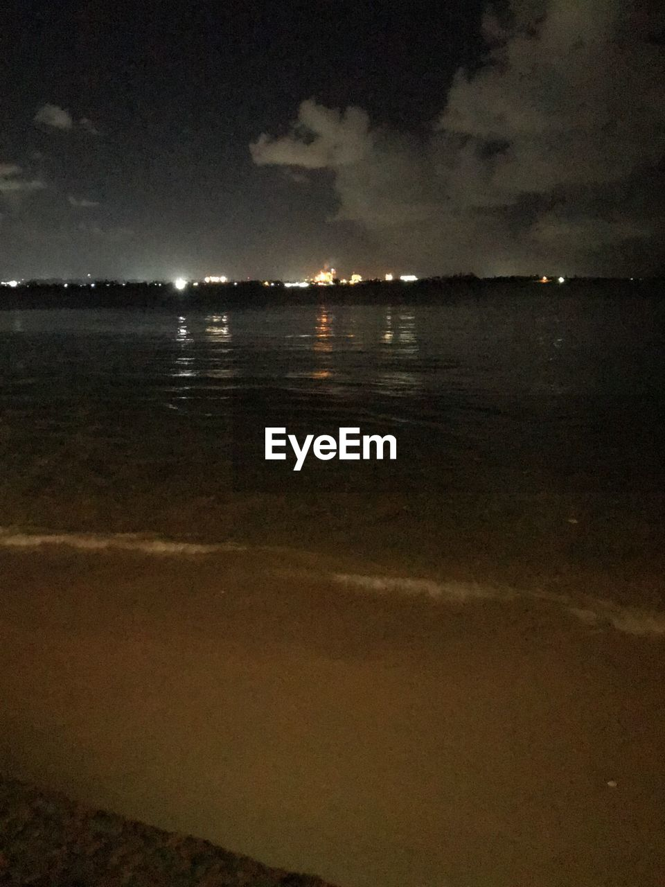 sky, cloud - sky, water, nature, night, tranquility, beach, sea, scenics - nature, beauty in nature, no people, land, tranquil scene, outdoors, environment, reflection, illuminated, dark, dusk