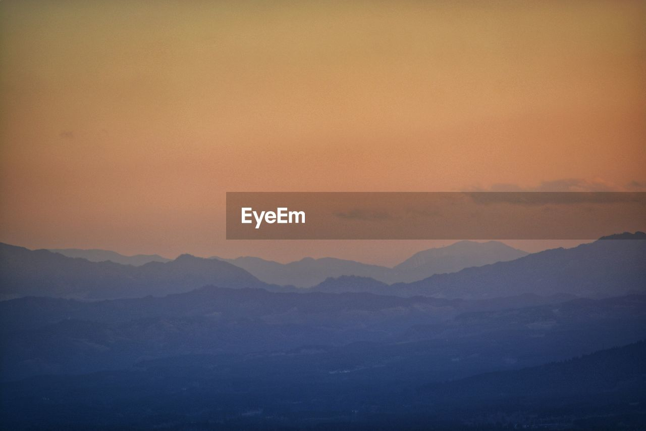 mountain, scenics - nature, beauty in nature, sky, mountain range, tranquil scene, tranquility, sunset, landscape, environment, no people, non-urban scene, idyllic, nature, cloud - sky, majestic, outdoors, remote, silhouette, mountain peak