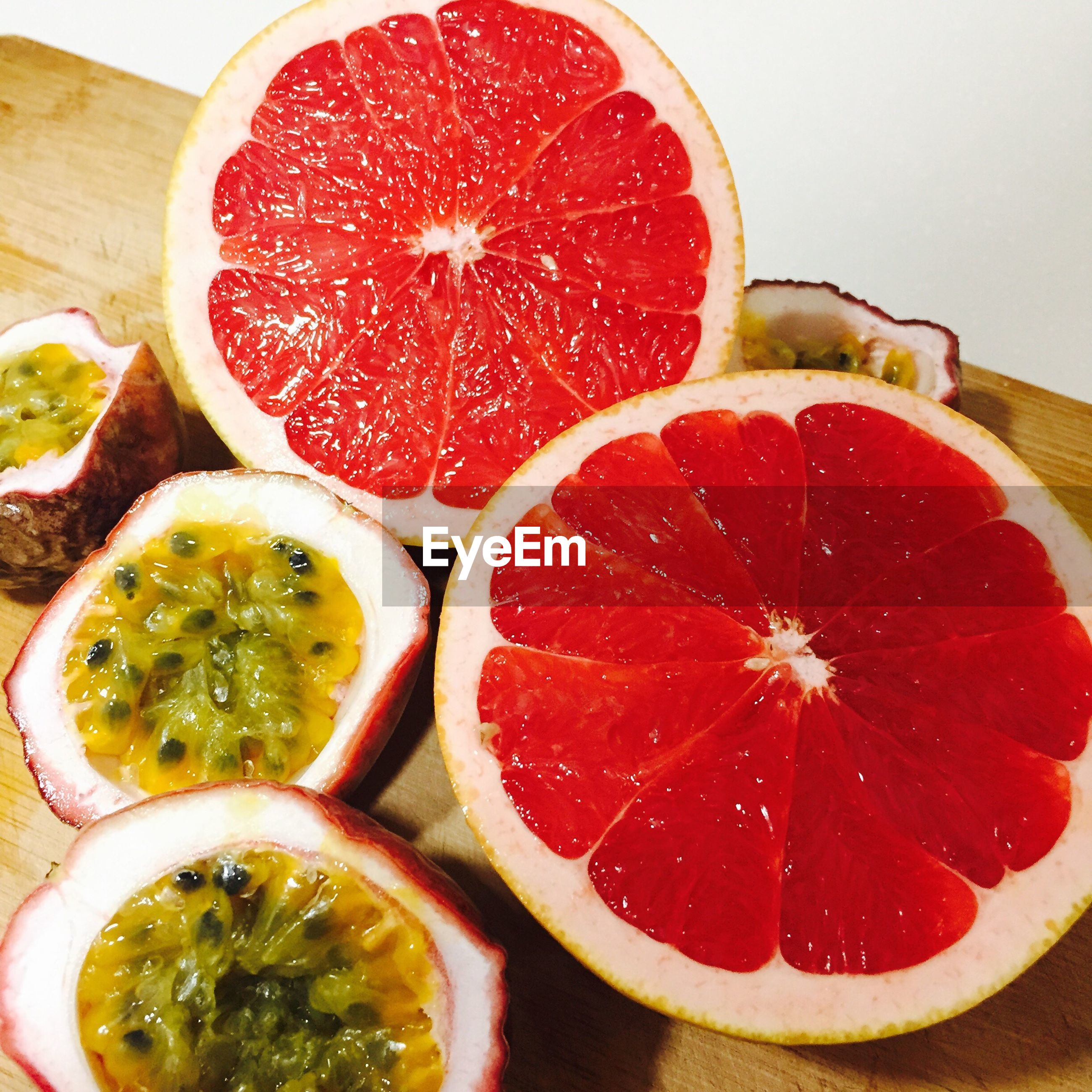 food and drink, fruit, food, healthy eating, wellbeing, freshness, slice, still life, cross section, red, close-up, indoors, no people, citrus fruit, table, halved, group of objects, juicy, organic, ripe, orange, passion fruit