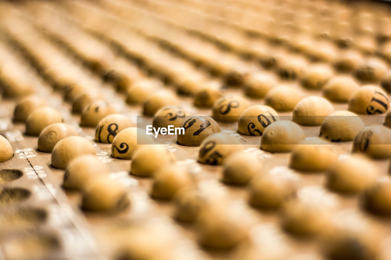 Close-Up Of Wooden Lottery Balls On Tray