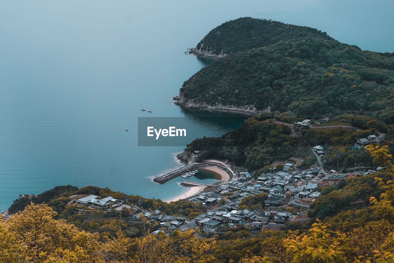 High angle view of bay against clear sky