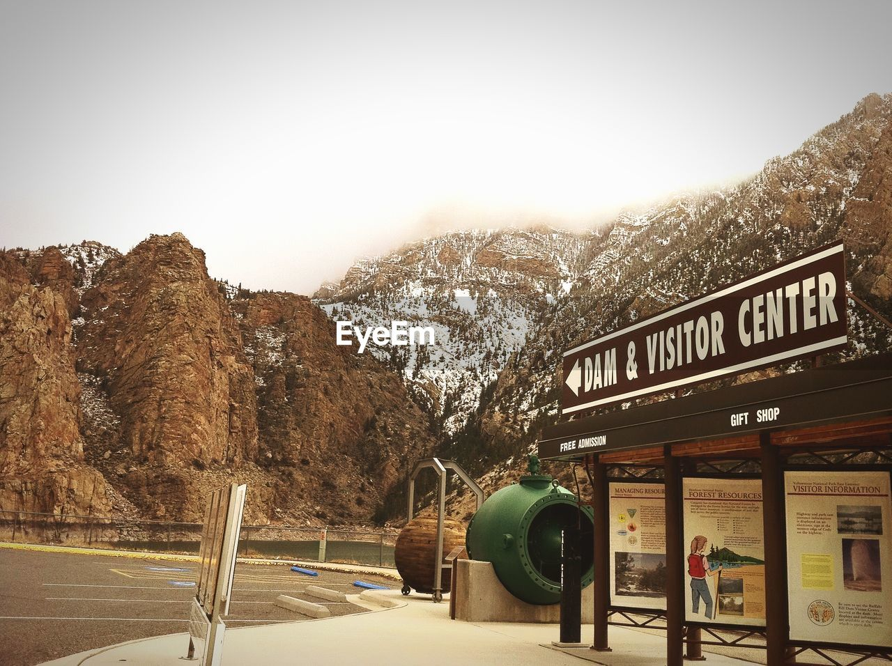 mountain, text, communication, western script, sign, sky, nature, mountain range, scenics - nature, day, information, no people, script, road, information sign, beauty in nature, transportation, guidance, non-western script, outdoors