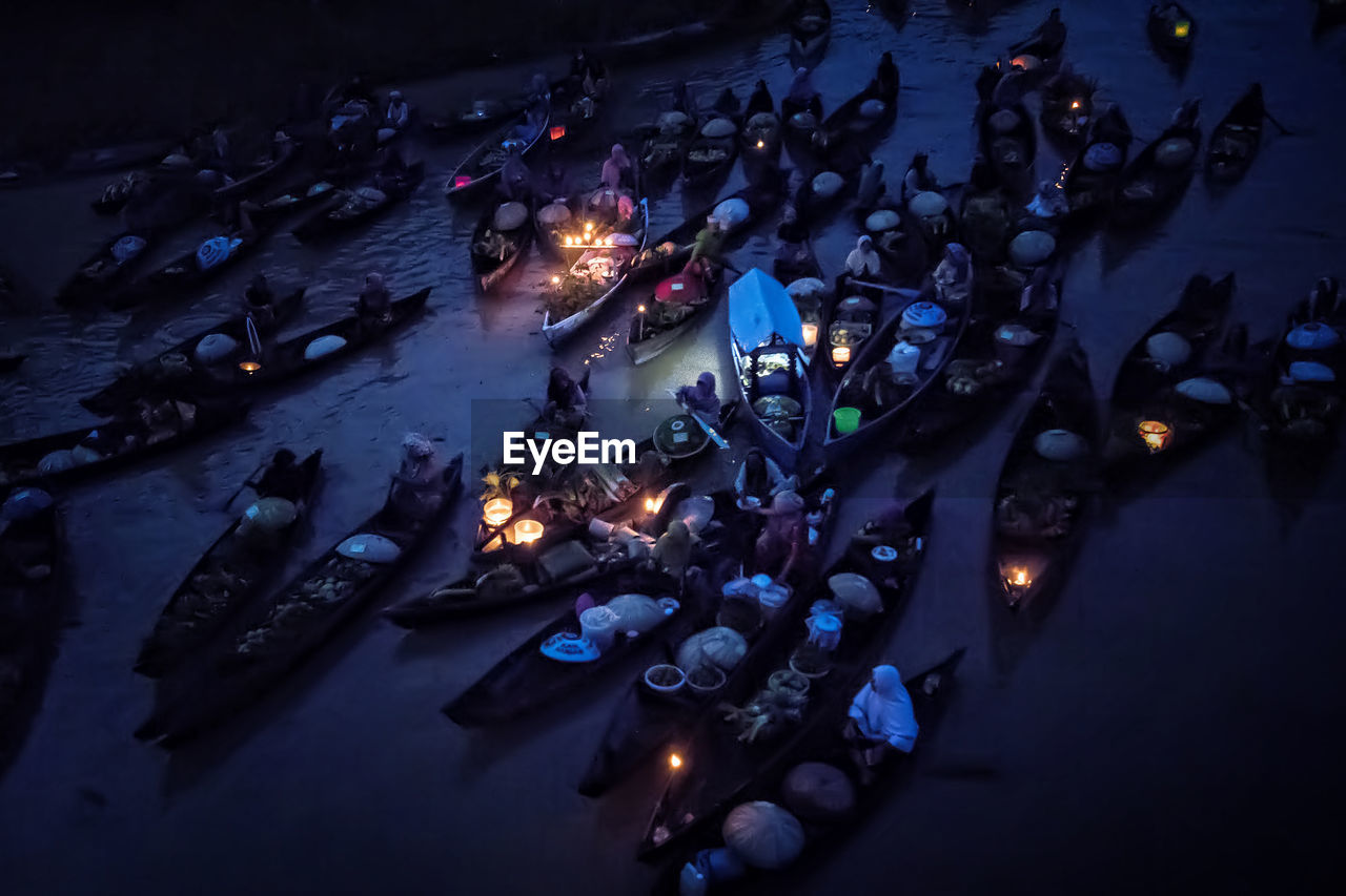 High Angle View Of People Sailing In Floating Market At Night