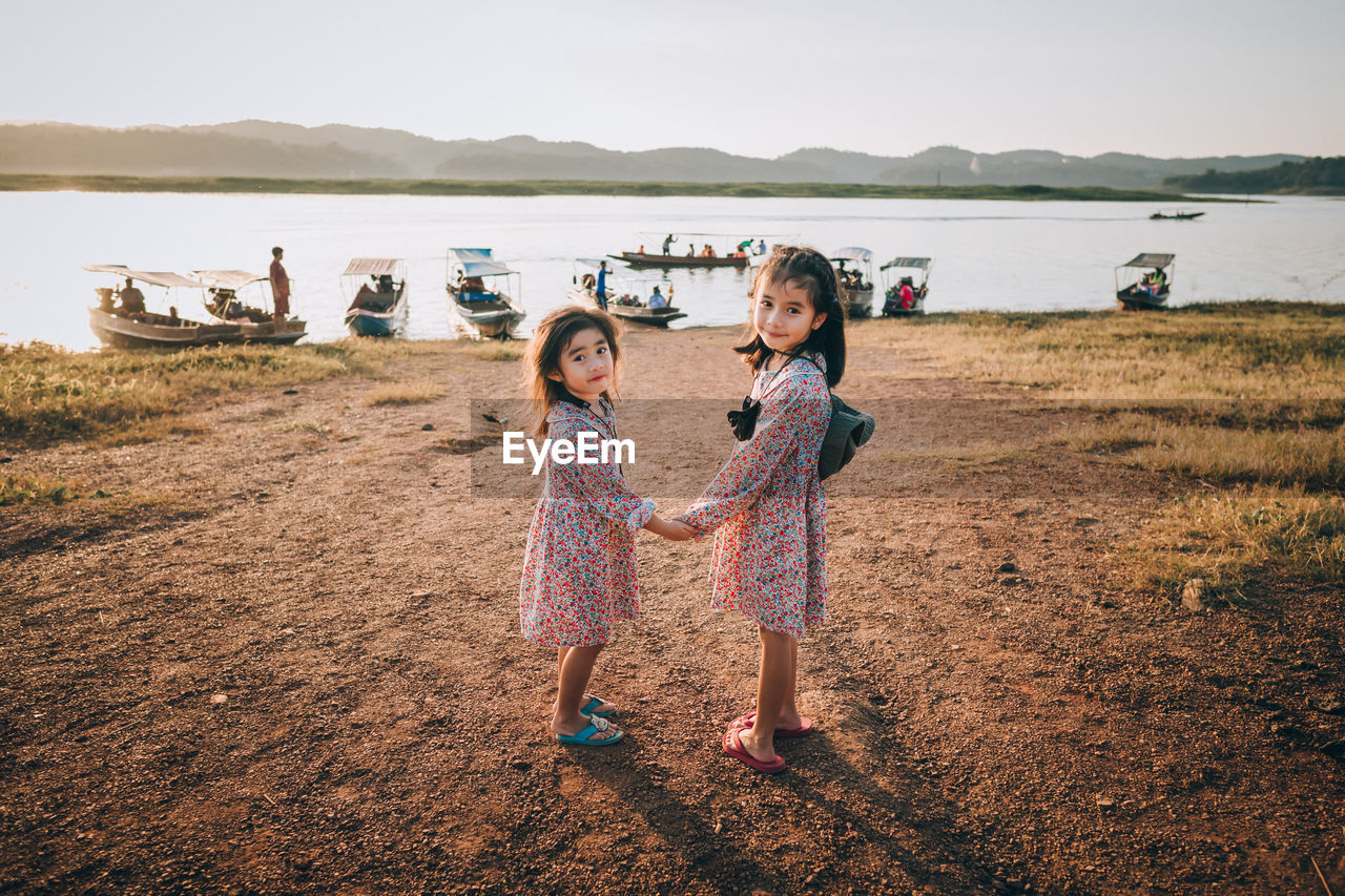 Two children going in forest near the lake