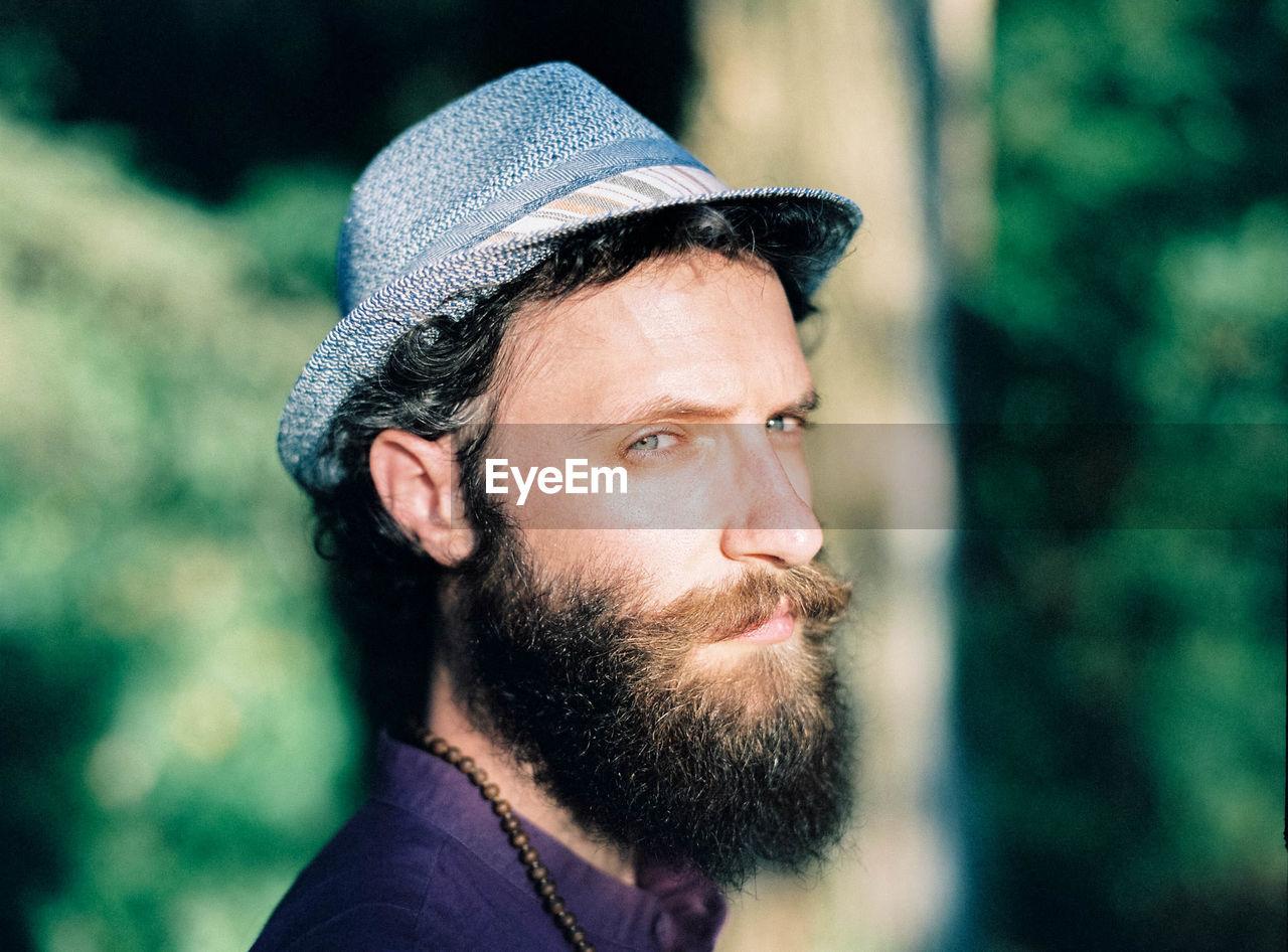 Close-Up Portrait Of Bearded Man Wearing Hat