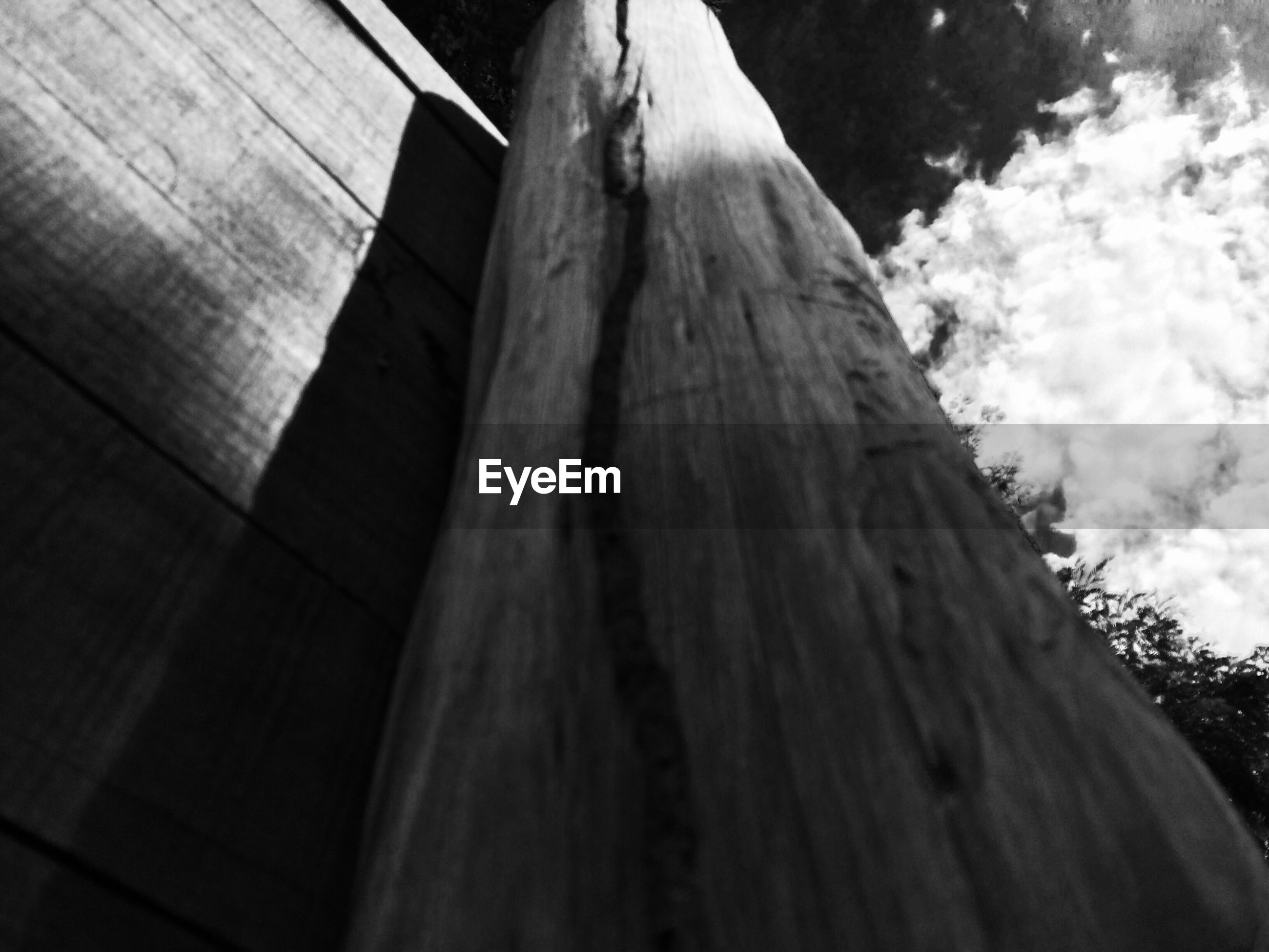 low angle view, wood - material, sky, wooden, day, tree, wood, outdoors, cloud - sky, sunlight, nature, no people, built structure, part of, shadow, tranquility, tilt, textured, close-up, pattern