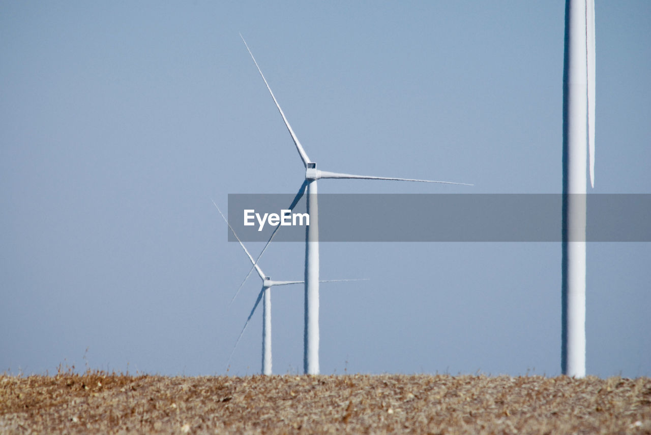 environment, fuel and power generation, wind turbine, turbine, environmental conservation, renewable energy, wind power, alternative energy, sky, landscape, clear sky, nature, land, rural scene, blue, field, day, technology, agriculture, no people, outdoors, electricity, sustainable resources, power supply