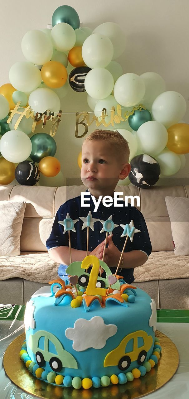 PORTRAIT OF CUTE BOY WITH BALLOONS