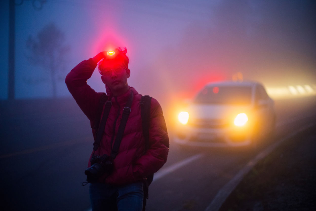 Man With Illuminated Headlamp During Foggy Weather At Night