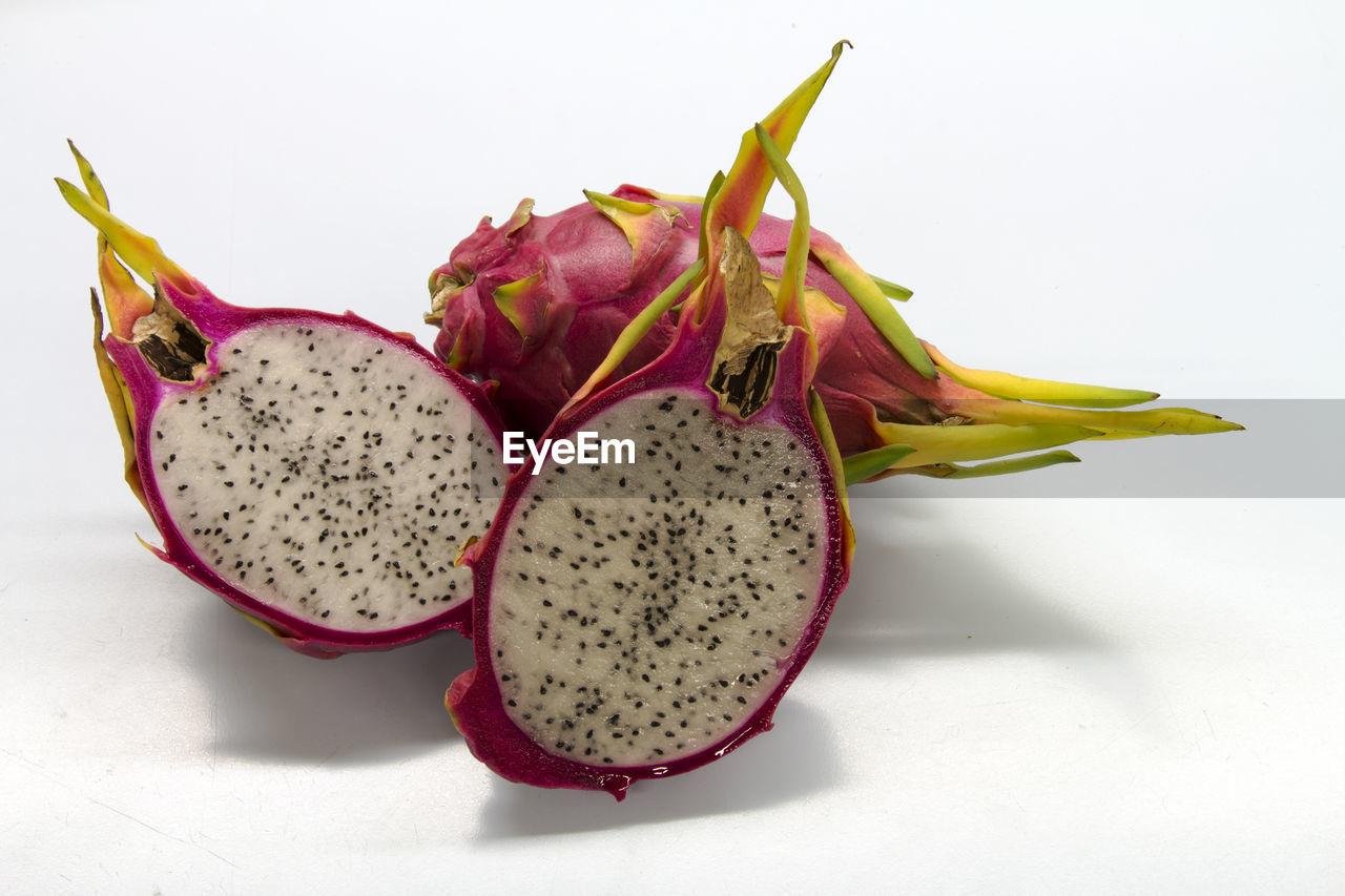 Close-up of pitayas against white background