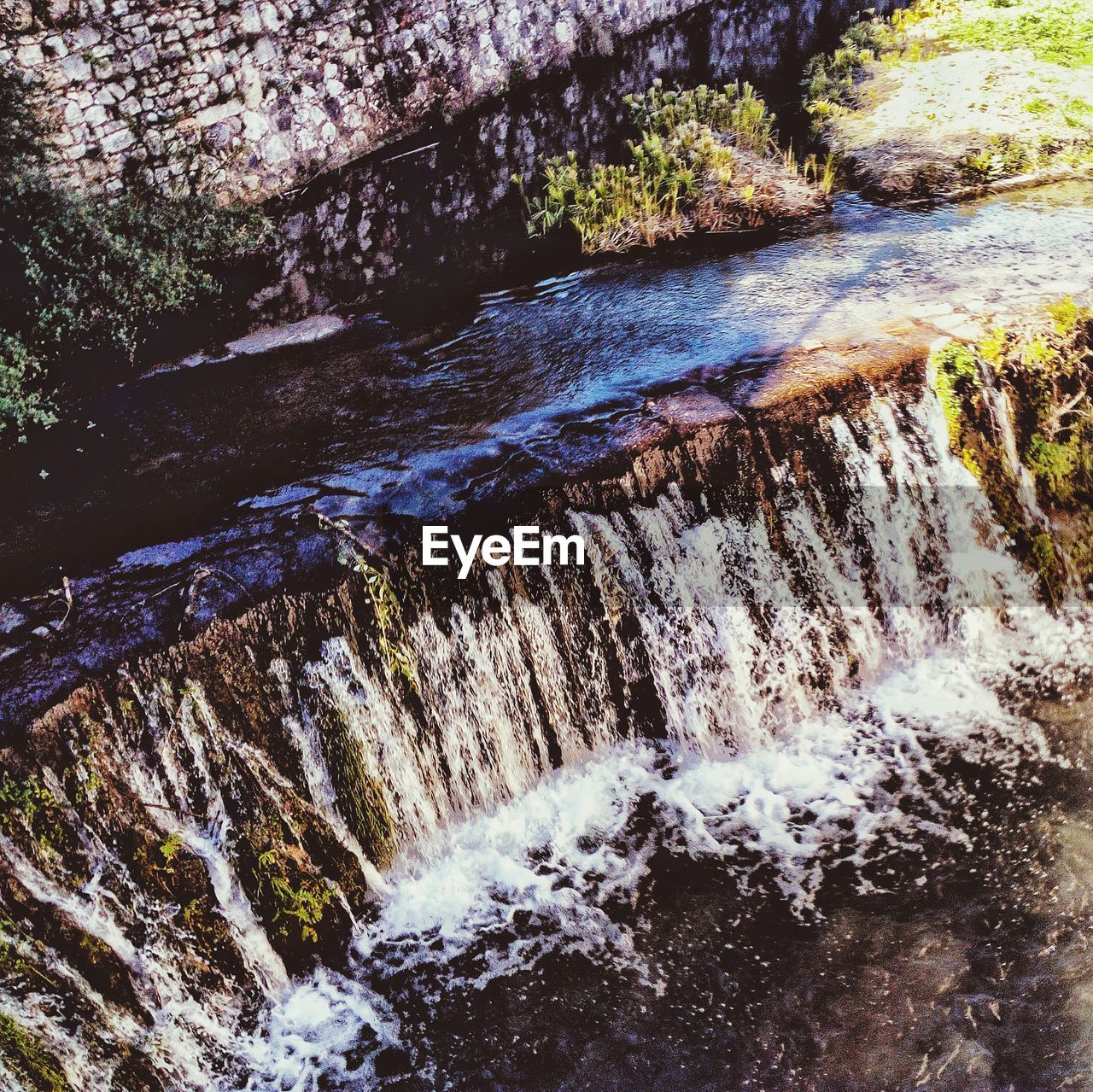 water, motion, waterfall, flowing water, nature, beauty in nature, rock - object, river, day, long exposure, scenics, blurred motion, outdoors, no people, forest, rapid, tranquility, tranquil scene, power in nature, tree, running water, hot spring