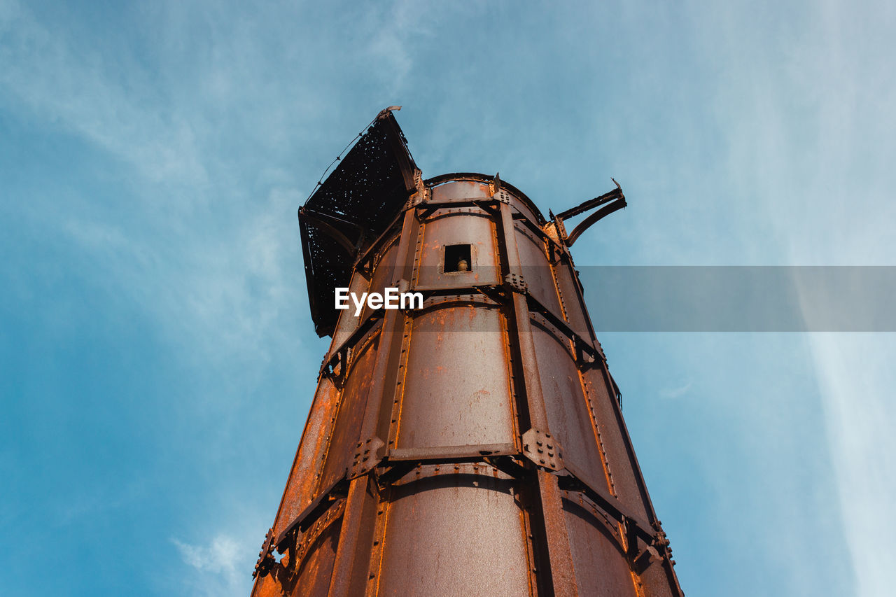 Low angle view of old lighthouse against sky