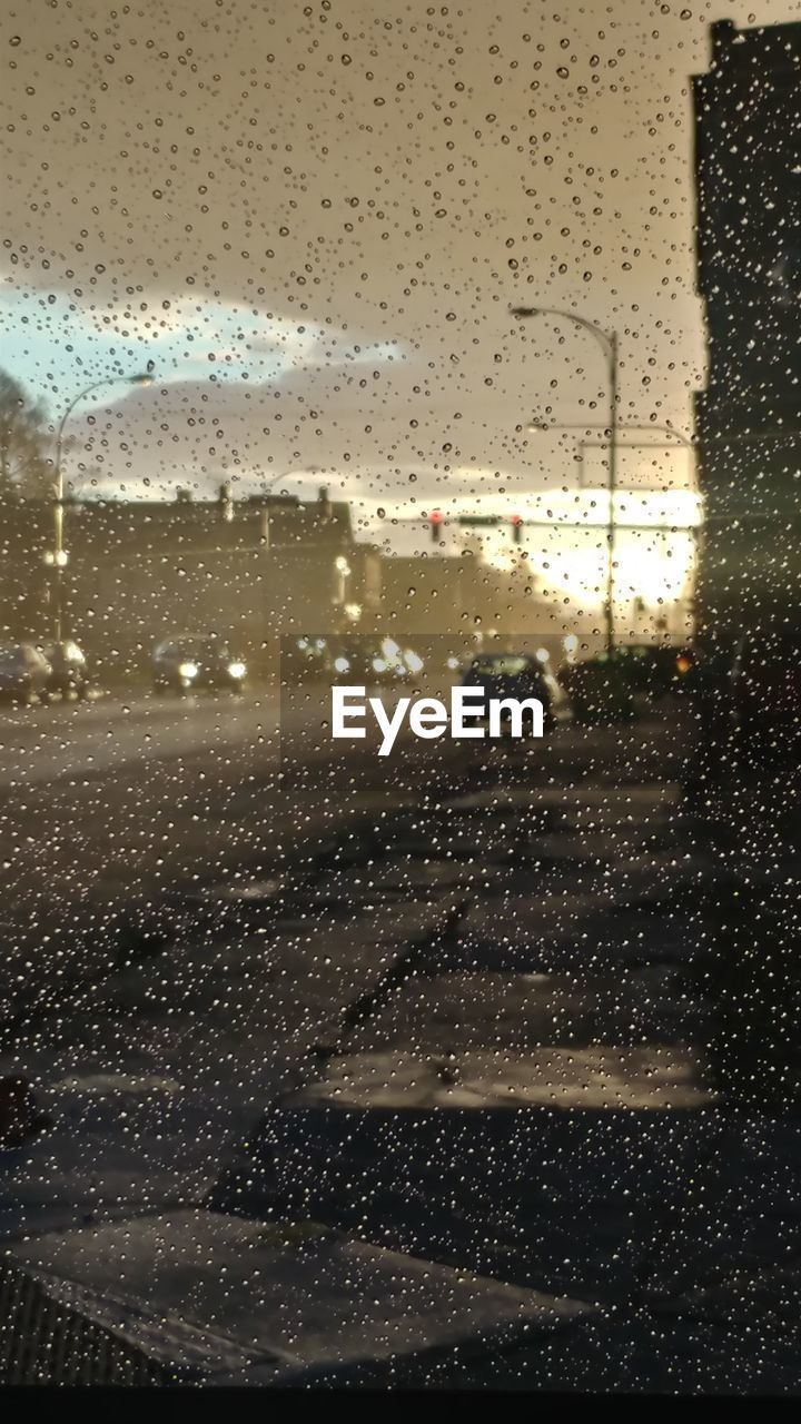 rain, drop, wet, weather, raindrop, rainy season, window, glass - material, water, torrential rain, windshield, condensation, storm cloud, car, indoors, storm, no people, sky, illuminated, thunderstorm, day, nature