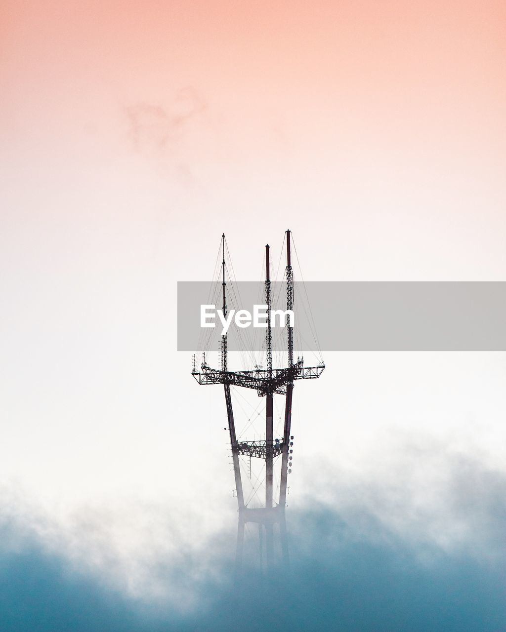 Aerial view of crane during foggy weather at sunset