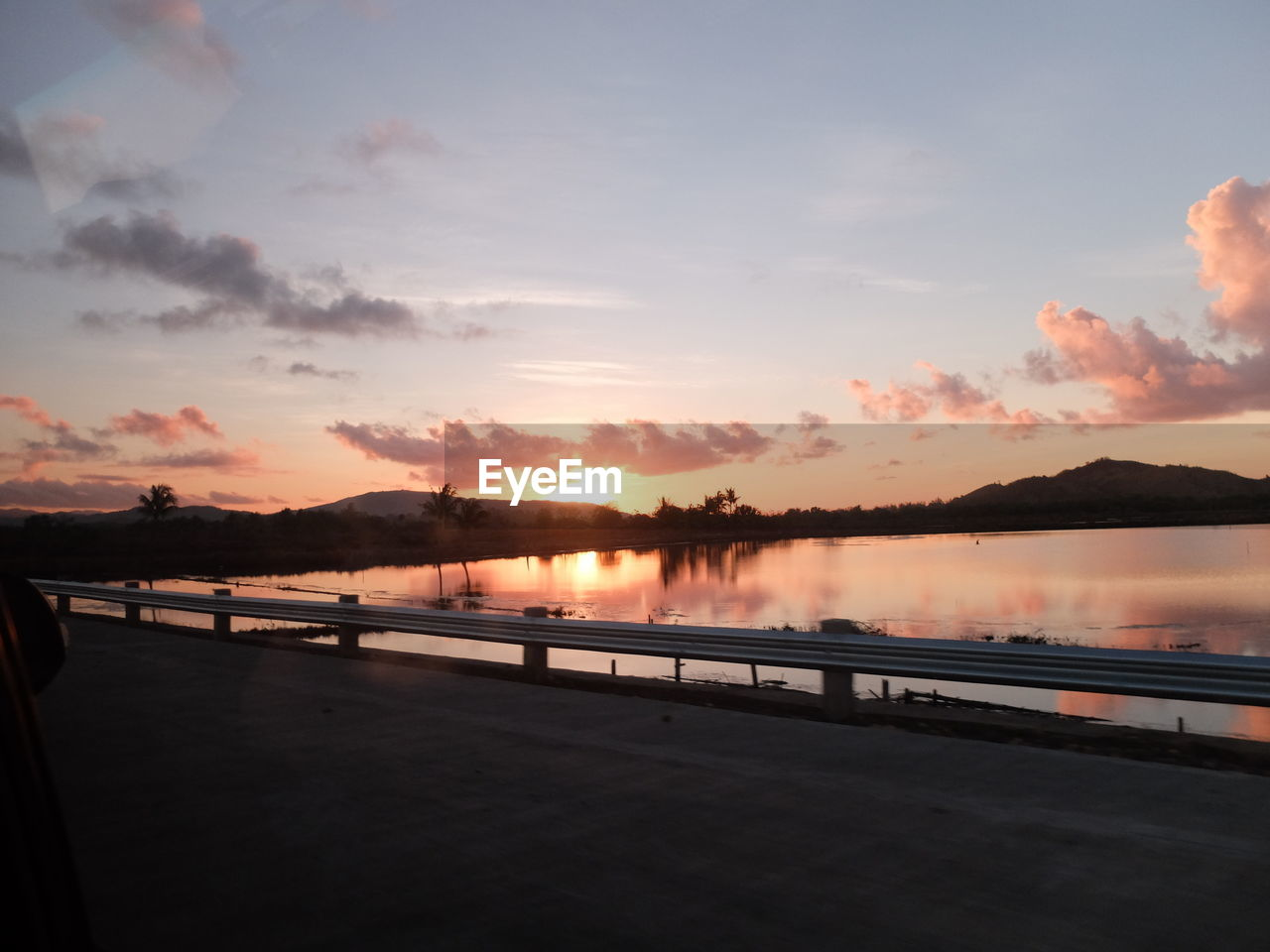 sky, sunset, cloud - sky, water, beauty in nature, scenics - nature, nature, tranquility, tranquil scene, orange color, reflection, transportation, railing, no people, lake, outdoors, non-urban scene, idyllic, connection