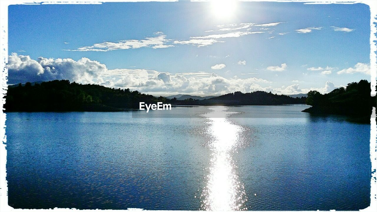 water, sky, reflection, sun, nature, sunlight, lake, scenics, mountain, no people, beauty in nature, outdoors, day