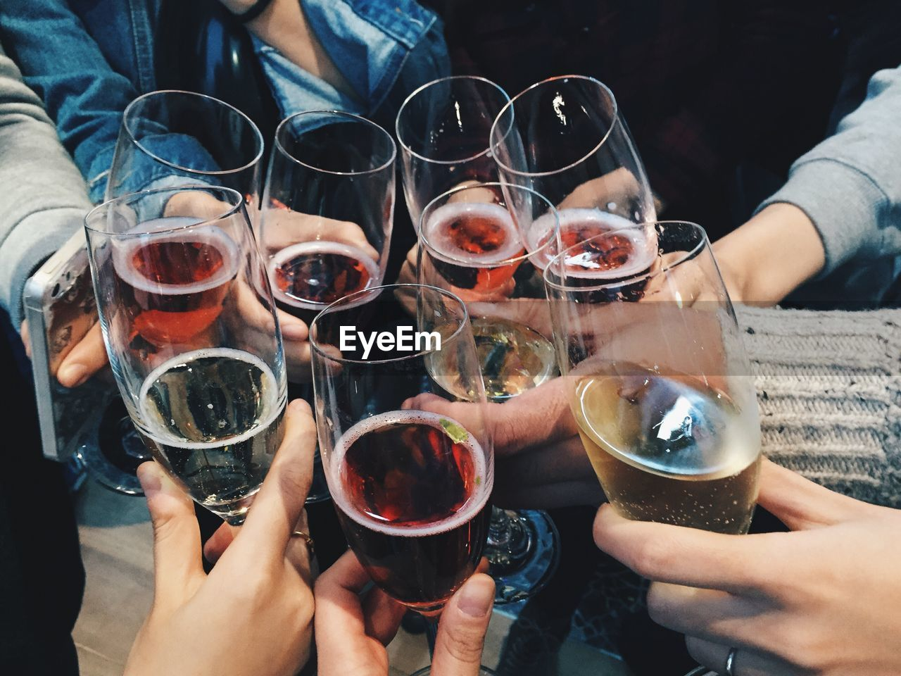 group of people, friendship, refreshment, drink, food and drink, human hand, real people, hand, celebratory toast, lifestyles, alcohol, holding, togetherness, women, medium group of people, men, leisure activity, adult, glass, people, red wine