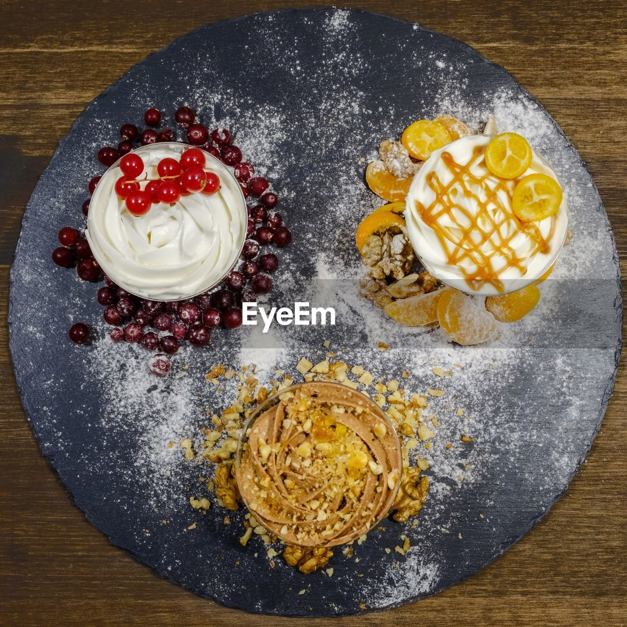 Directly above shot of desserts on slate over table