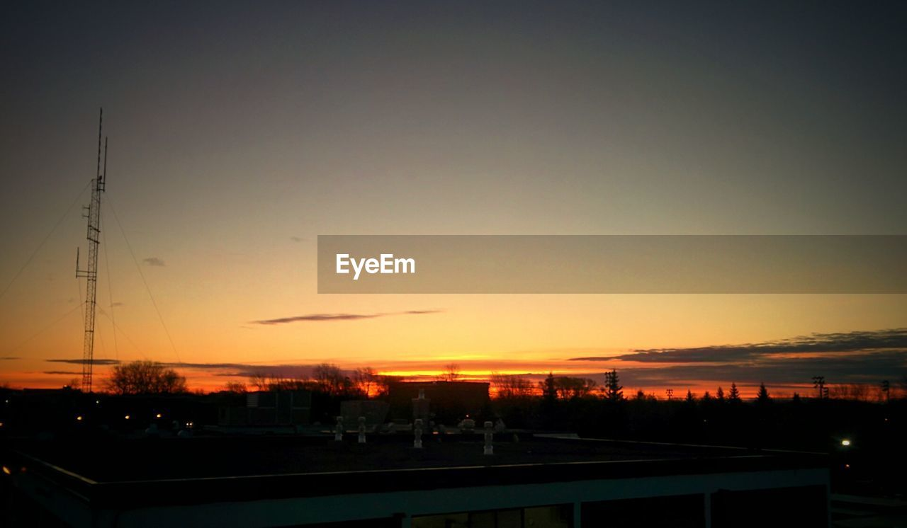 sunset, silhouette, sky, nature, dusk, no people, outdoors, beauty in nature, building exterior, architecture, built structure, scenics, clear sky, water, city