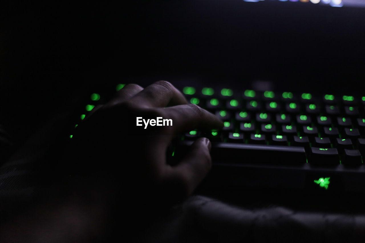 Close-Up Of Hand Using Computer Keyboard