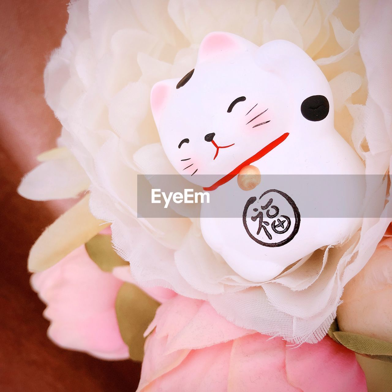 pink color, flowering plant, close-up, plant, flower, freshness, fragility, vulnerability, representation, white color, beauty in nature, no people, petal, art and craft, nature, flower head, inflorescence, indoors, animal representation, high angle view, cherry blossom