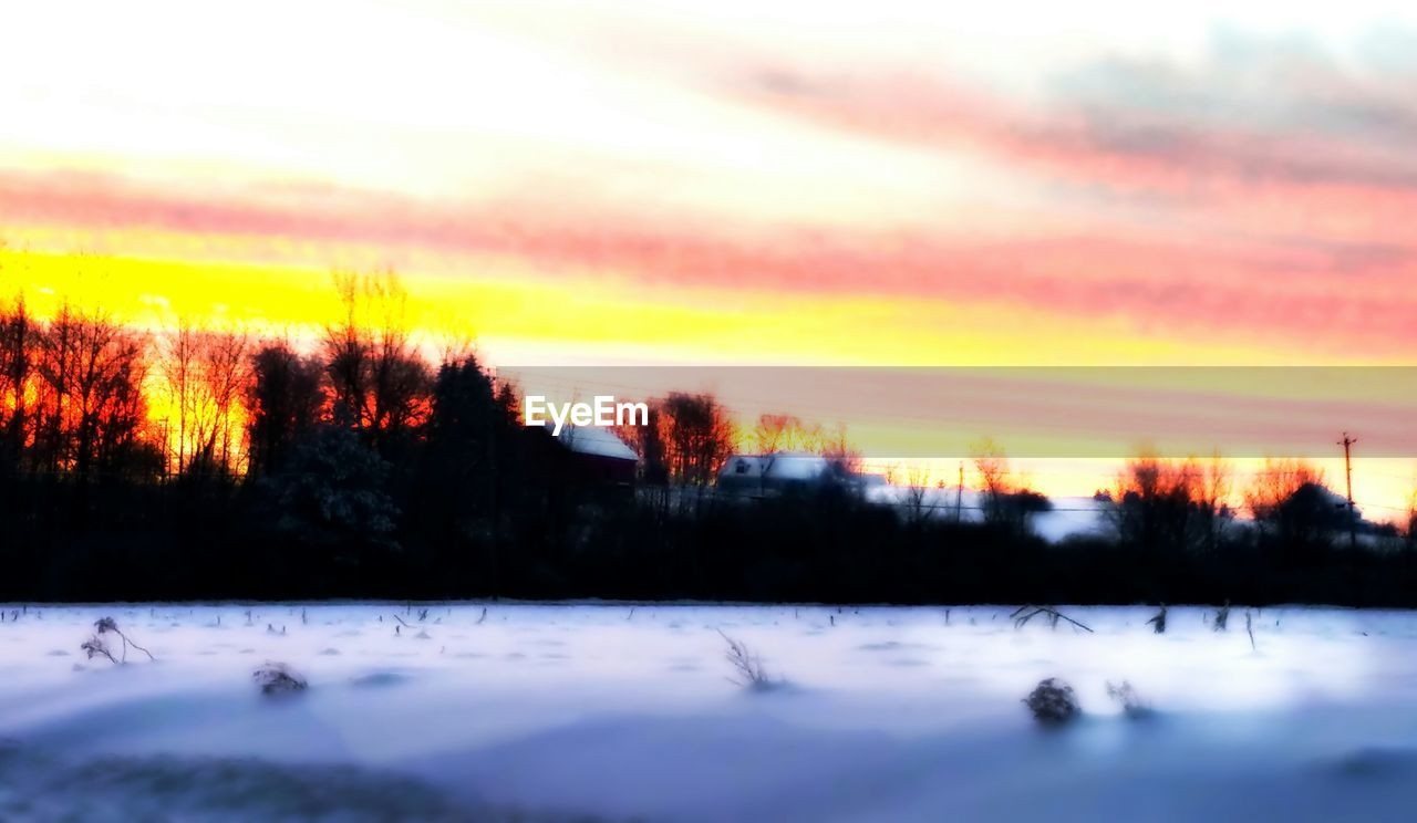sunset, nature, beauty in nature, scenics, tranquil scene, tranquility, tree, cold temperature, winter, sky, no people, snow, ice, landscape, lake, outdoors, cloud - sky, water, forest, day