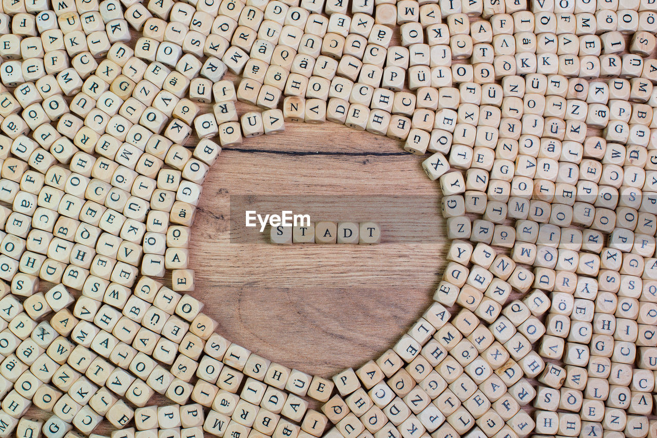 High angle view of text on wood