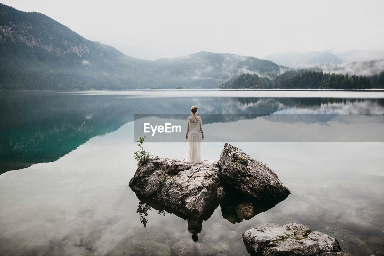 Woman In Lake Against Mountains