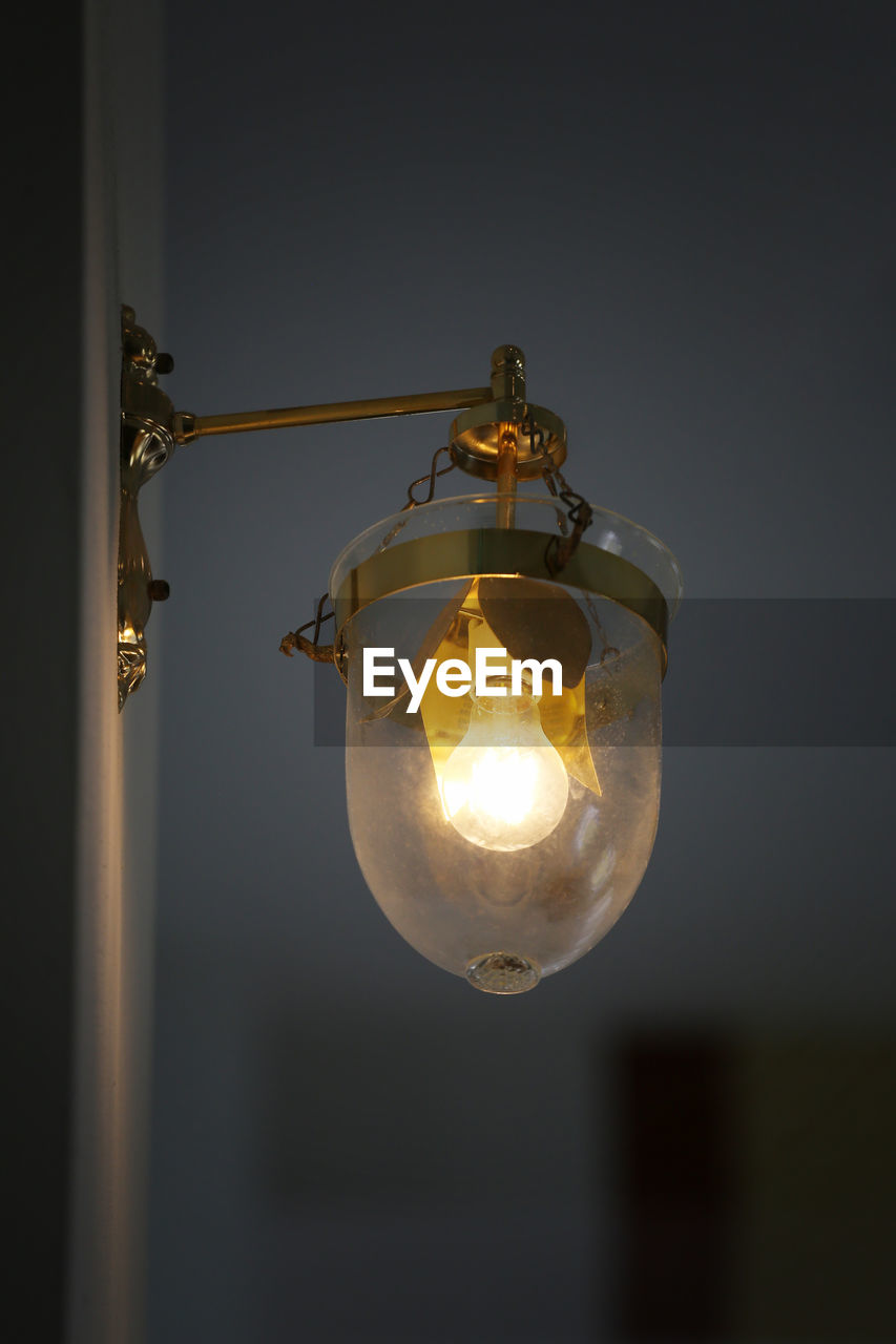 lighting equipment, illuminated, electricity, light bulb, hanging, close-up, no people, electric light, low angle view, indoors, focus on foreground, light, glass - material, glowing, transparent, bulb, technology, ceiling, selective focus, electric lamp, electrical equipment