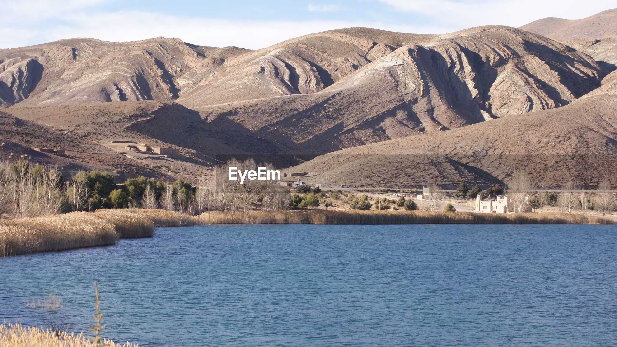 Scenic view of lake in front of mountains