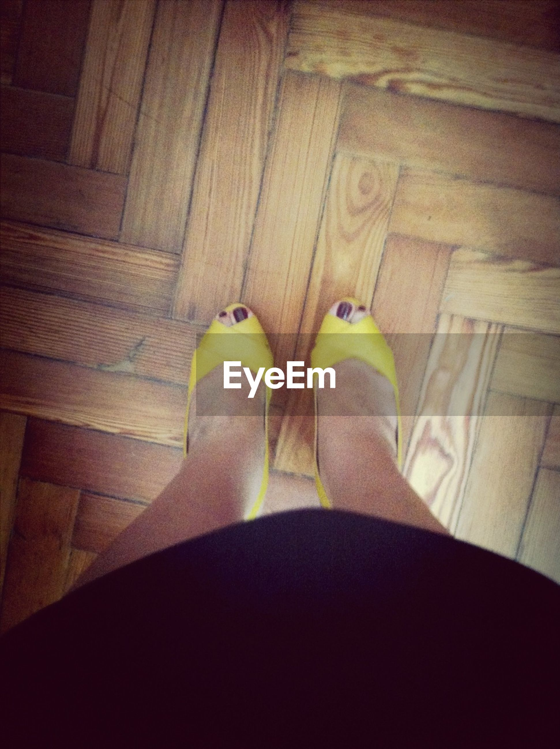 low section, person, indoors, personal perspective, shoe, lifestyles, high angle view, human foot, standing, flooring, leisure activity, footwear, relaxation, hardwood floor, sitting, part of