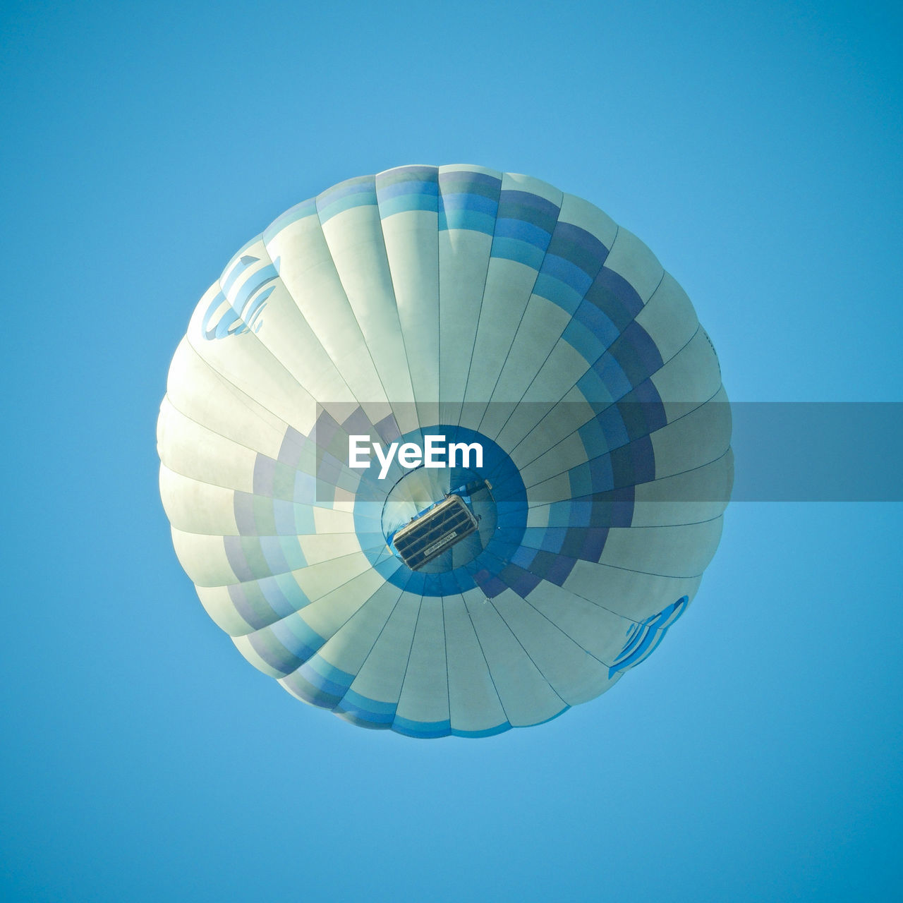 low angle view, adventure, parachute, clear sky, mid-air, flying, day, blue, extreme sports, outdoors, no people, ballooning festival, hot air balloon, sky