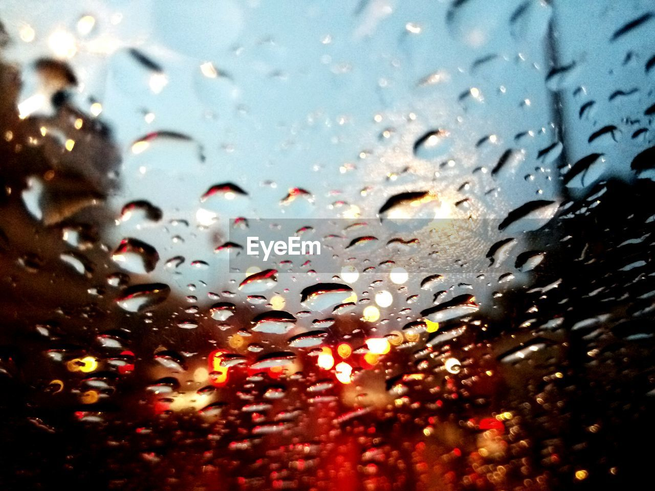 CLOSE-UP OF WATER DROPS ON WINDOW