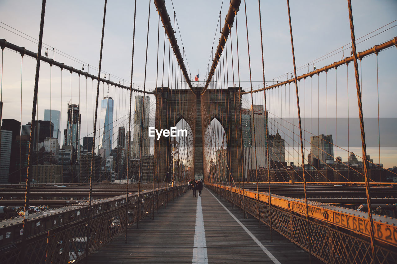 Brooklyn Bridge Against Cloudy Sky