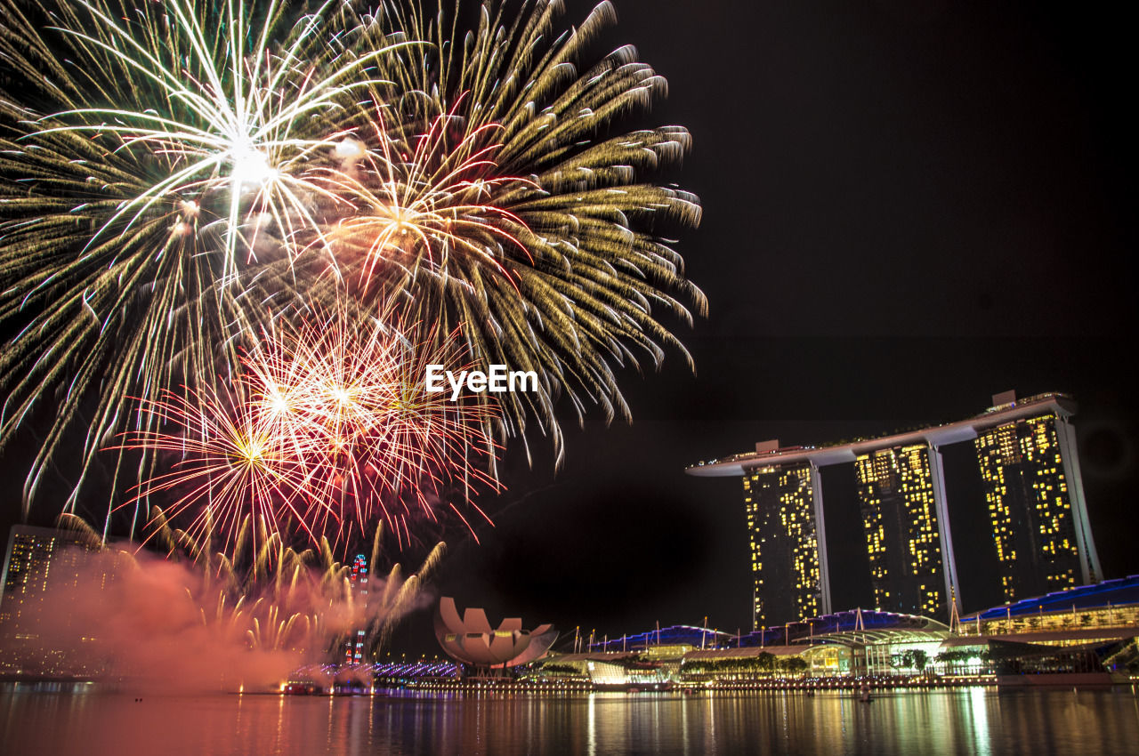 night, celebration, firework display, illuminated, firework - man made object, arts culture and entertainment, event, water, low angle view, sky, no people, outdoors