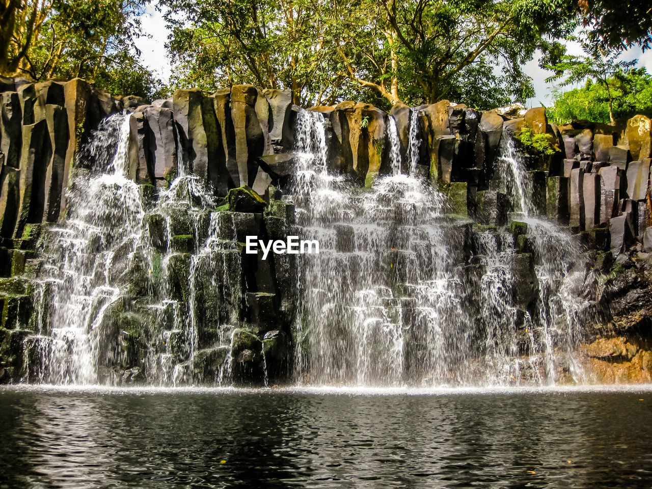 waterfall, water, motion, scenics, river, nature, beauty in nature, splashing, no people, travel destinations, long exposure, outdoors, rock - object, tourism, travel, waterfront, tree, day, vacations, power in nature, freshness