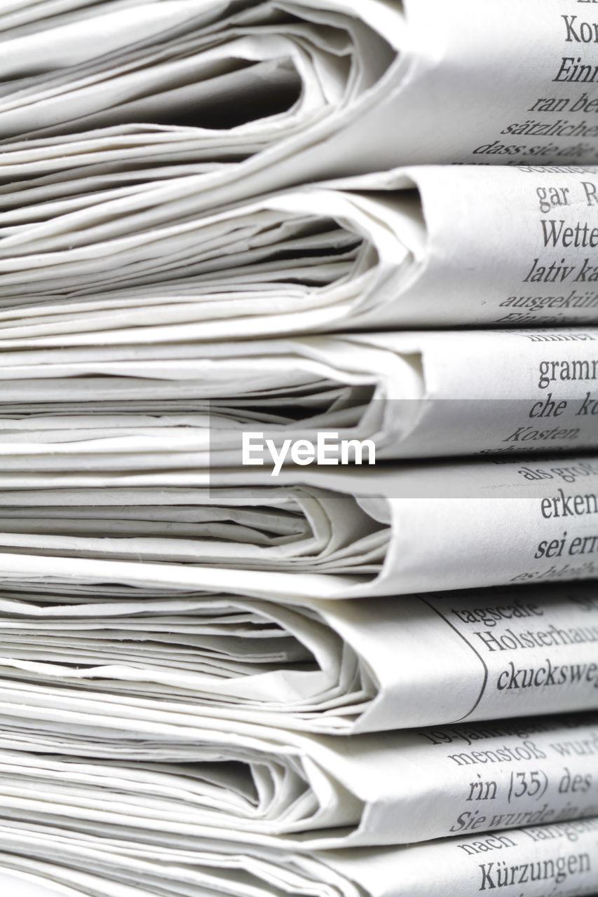 Full frame shot of newspaper stack