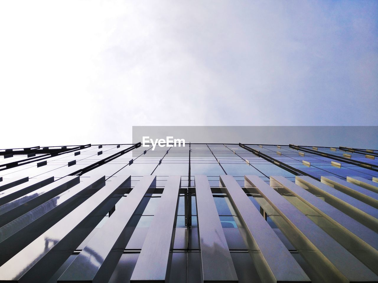 low angle view, architecture, day, built structure, sky, outdoors, no people, building exterior, modern