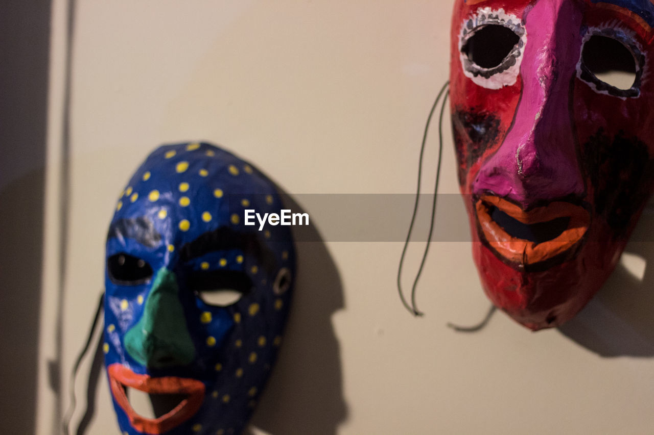 mask - disguise, venetian mask, carnival - celebration event, disguise, mask, human representation, focus on foreground, carnival, close-up, multi colored, indoors, arts culture and entertainment, no people, skeleton, clown, halloween, day